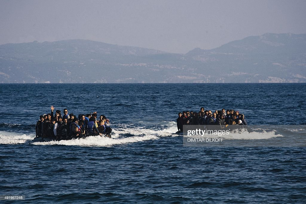 Migrants arrive by boat on the Greek island of Lesbos after crossing the Aegean sea from Turkey on October 9 2015 Europe is grappling with its...