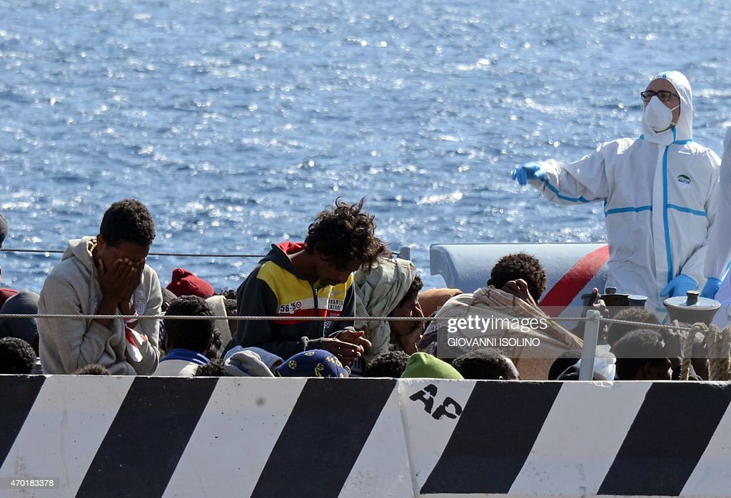 Migrants arrive in the port of Messina after a rescue operation at see on April 18 2015 in Sicily A surge of migrants pouring into Europe from across...
