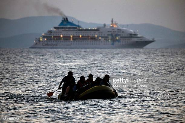 Migrants arrive on the shore of Kos island on a small dinghy on August 19 2015 Authorities on the island of Kos have been so overwhelmed that the...