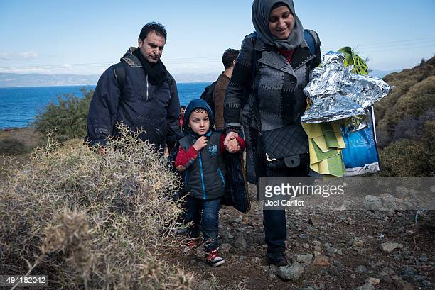 Migrants arriving on the beach in Lesbos, Greece