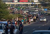 Migrants begin walking towards the Austrian border on September 4 2015 in Bicske near Budapest Hungary Several thousand migrants began walking today...
