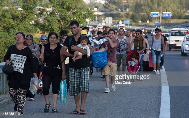 Migrants begin walking towards the Austrian border on September 4 2015 in Bicske near Budapest Hungary Several thousand migrants began walking today...