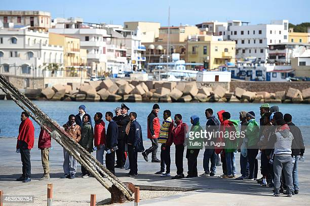 Migrants board a ship on February 20 2015 in Lampedusa Italy Hundreds of migrants recently arrived in Lampedusa after fleeing the attacks by ISIS in...