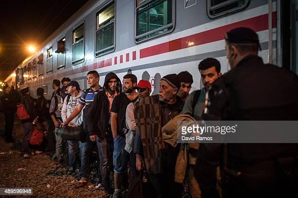 Migrants board a train heading Zagred at Tovarnik station as more migrants arrive from the Serbian border on September 22 2015 in Tovarnik Croatia...