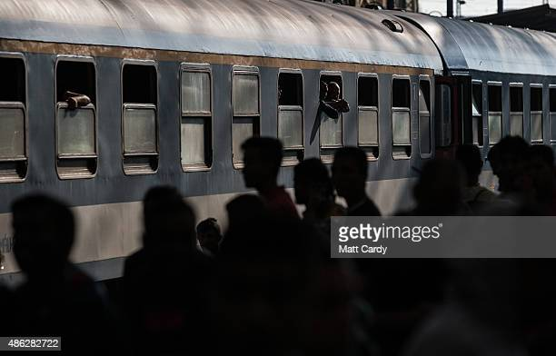 Migrants board a train in Keleti station after it was reopened this morning in central Budapest on September 3 2015 in Budapest Hungary Although the...