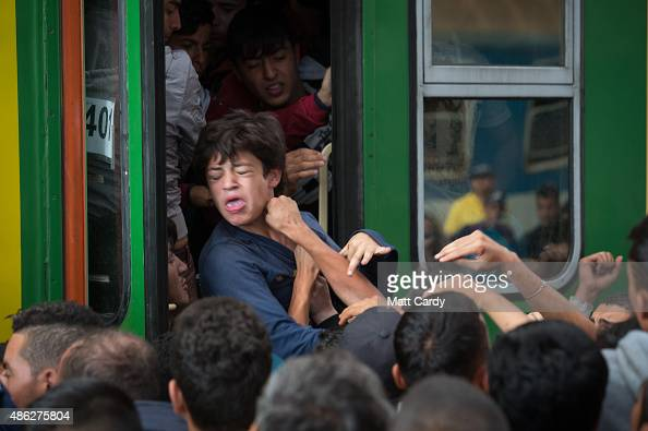 Migrants board trains in Keleti station after it was reopened this morning in central Budapest on September 3 2015 in Budapest Hungary Although the...