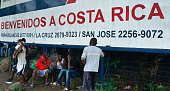 Migrants by a banner that reads 'Welcome to Costa Rica' in an encampment of Africans in Penas Blancas Guanacaste Costa Rica in the border with...
