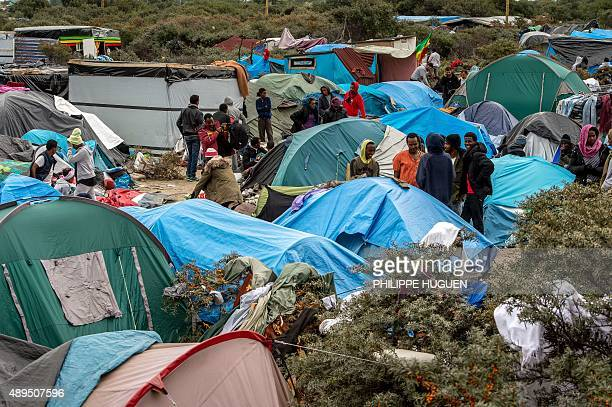 Migrants camp at a site dubbed the 'New Jungle' where some 3000 people have set up camp most seeking desperately to get to England in Calais on...