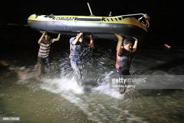 Migrants carrying boat try to reach Greece's Kos Island from the Akyarlar coast in Bodrum district of Mugla province in Turkey on September 4 2015