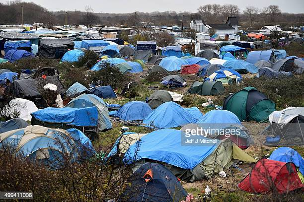 Migrants contend with wintery conditions in the camp known as the New Jungle on December 1 2015 in Calais France Thousands of migrants continue to...