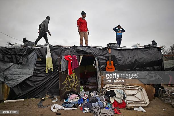 Migrants contend with wintery conditions in the camp known as the 'New Jungle' on December 1 2015 in Calais France Thousands of migrants continue to...