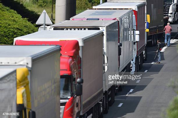 Migrants continue to try and board lorries bound for the United Kingdom on June 25 2015 in Calais France Many migrants are camped in Calais on the...