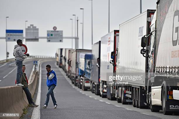Migrants continue to try and board lorries bound for the United Kingdom on June 26 2015 in Calais France Many migrants are camped in Calais on the...