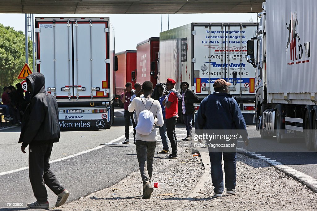 Migrants continue trying to board lorries bound for the United Kingdom on July 1 2015 in Calais France Crosschannel travel has be disrupted for a...