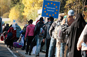Migrants cross border to Austria on October 28 2015 near Wegscheid Germany Bavarian Governor Horst Seehofer has accused the Austrian government of...