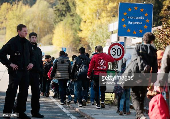 Migrants cross the German border to Austria on October 28 2015 near Wegscheid Germany Bavarian Governor Horst Seehofer has accused the Austrian...