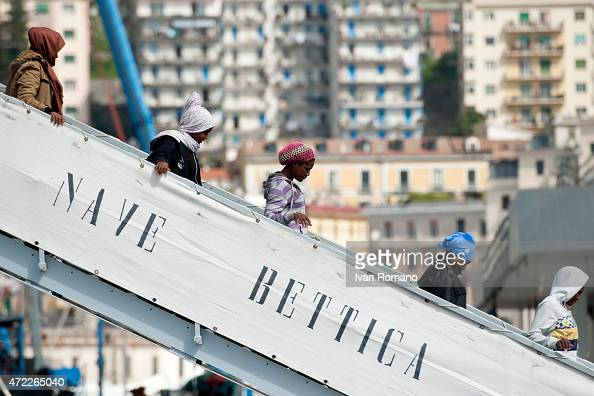 Migrants descend the stairs of the military ship 'Bettica' following a rescue operation at sea on May 5 2015 in the port of Salerno southern Italy...