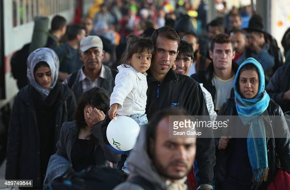 Migrants disembark from a governmentchartered train that brought them from Bavaria on September 24 2015 near Berlin in Schoenefeld Germany Germany is...