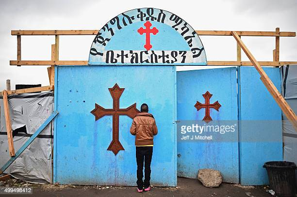 Migrants enter the church in the camp known as the New Jungle on December 1 2015 in Calais France Thousands of migrants continue to live in the...