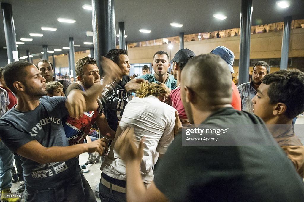 Migrants fight each other outside the main Eastern Railway station in Budapest, Hungary, September 1, 2015. Hundreds of angry migrants demonstrated on Tuesday demanding they be allowed to travel on to Germany, as the biggest ever influx of migrants into the European Union left its asylum policies in tatters.