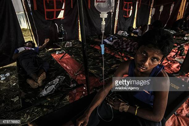 A migrants from Myanmar in care at camp shelters at the confinement area in the fishing port of Kuala Langsa in Aceh province May 17 2015 where...