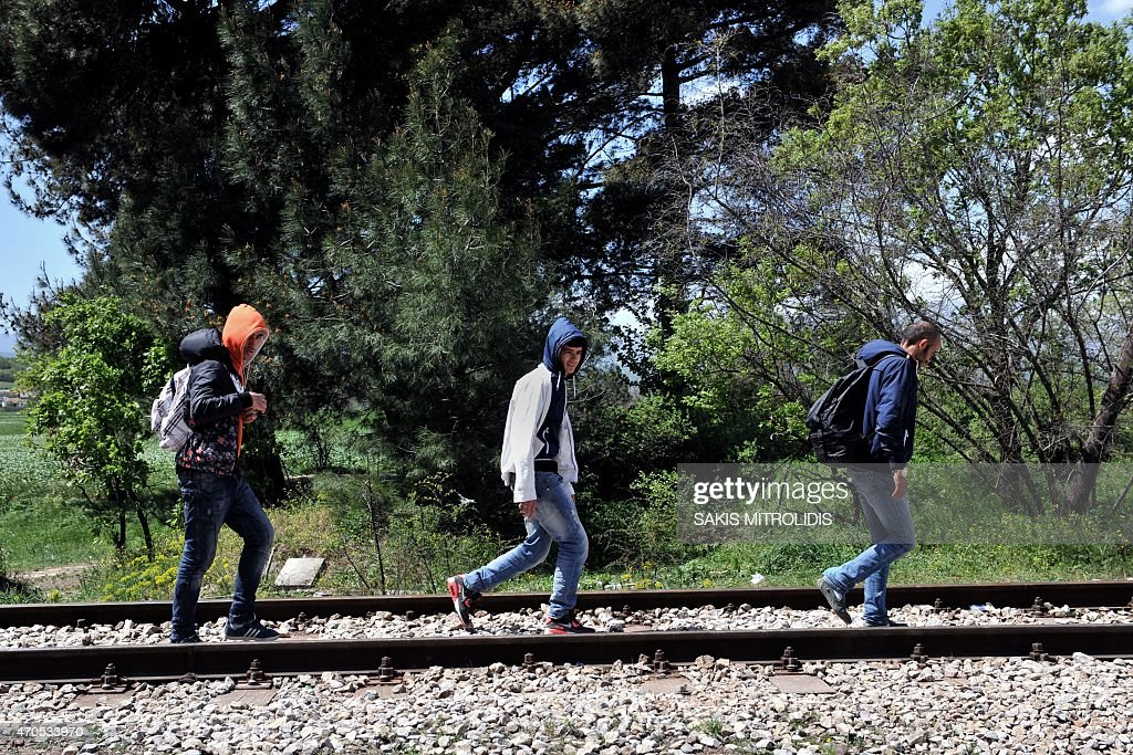 Migrants from Syria cross the railways at the border post of Idomeni some 600 km North of Athens at the GreeceMacedonia border on April 21 2015 Since...