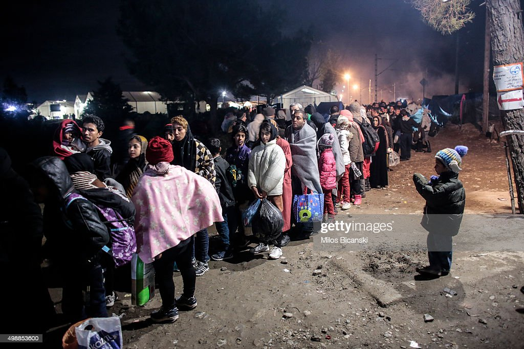 Migrants from Syria waits in line to cross the border near the northern Greek village of Idomeni on November 26 2015 at the GreekMacedonian border...