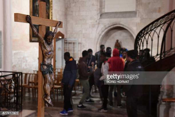 Migrants gather as they occupy the church of Saint Ferreol in Marseille with members of associations on November 22 2017 to protest against the life...