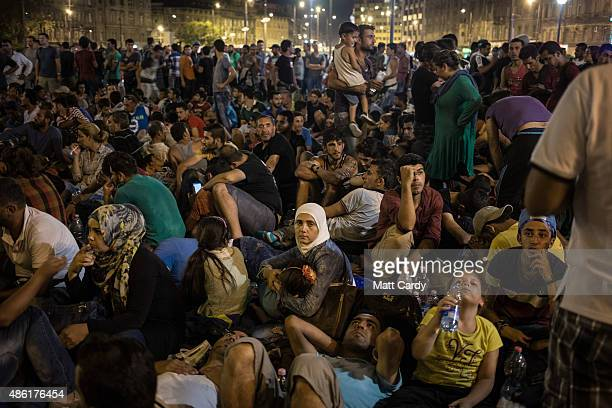 Migrants gather in front of Keleti station in central Budapest on September 1 2015 in Budapest Hungary The station was closed today and was said to...