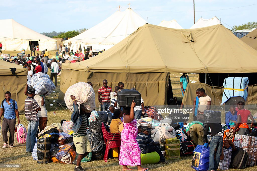 Migrants gather to a refugee camp as xenophobic attacks happen frequently on April 21 2015 in Durban South Africa After xenophobic attacks which have...