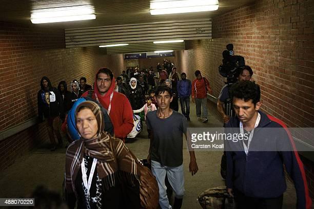 Migrants leave the trainstation after arriving on an ICE highspeed train of Deutsche Bahn from Munich near Berlin on September 13 2015 in Schoenefeld...