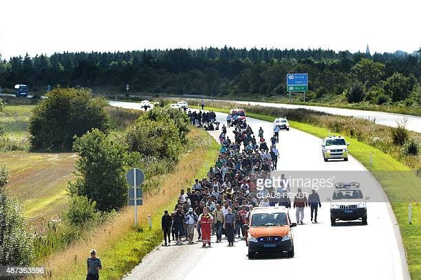 Migrants mainly from Syria and Iraq walk at the E45 freeway from Padborg on the DanishGerman border heading north to try to get to Sweden on...