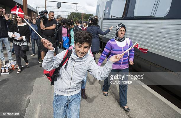 Migrants mainly from Syria make their way to board a train to Sweden at the train station in Padborg Denmark on September 10 2015 AFP PHOTO / SCANPIX...