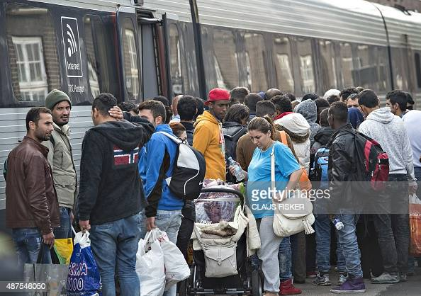 Migrants mainly from Syria wait to board a train to Sweden at the train station in Padborg Denmark on September 10 2015 AFP PHOTO / SCANPIX DENMARK /...