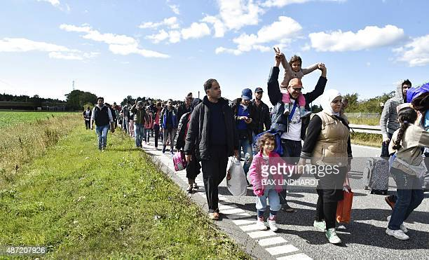 Migrants mainly from Syria walk on the highway 12km north of Rodby Denmark moving to the north on September 7 2015 The refugees want to reach Sweden...