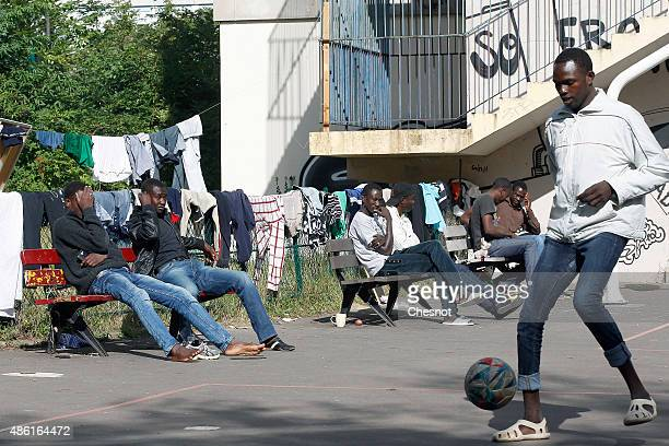 Migrants occupy the Jean Quarre school in the nineteenth district on September 1 2015 in Paris France Migrants found the school which has been empty...