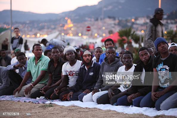Migrants pray for the start of ramadan as they gather at the French border hoping to enter the country on June 17 2015 in Ventimiglia Italy A group...