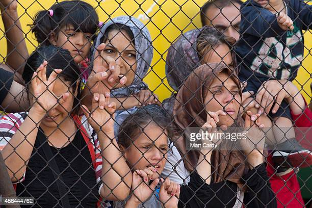 Migrants protest outside a train that they are refusing to leave for fear of being taken to a refugee camp from the train that has been held at...