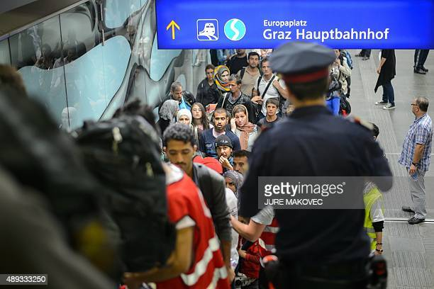 Migrants queue to board buses upon their arrival in Graz on September 20 2015 Some 150 migrants entered Austria from across the Slovenian border...