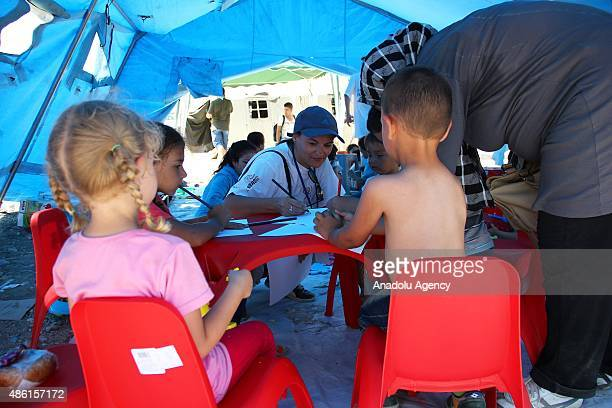 Migrants receive aid from the Red Cross and United Nations High Commissioner for Refugees teams on the Macedonia border in Gevgelija Macedonia on...