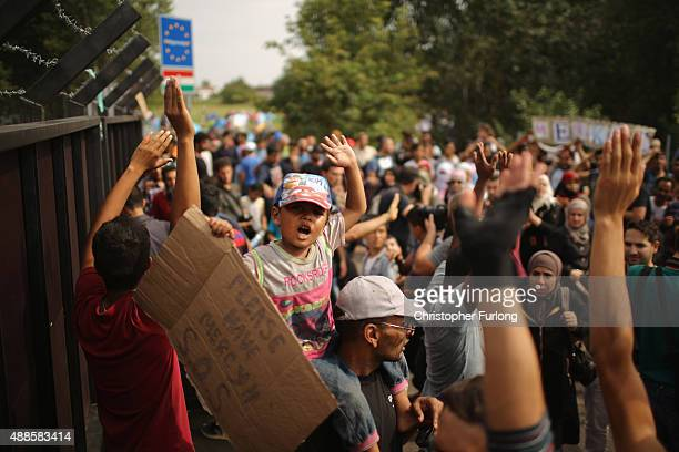 Migrants remonstrate with Hungarian police before they were hit with pepper spray water cannons and tear gas at the Horgos border post on September...