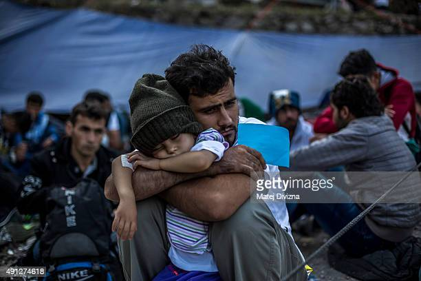 Migrants rest at a checkpoint as they arrived with other refugees on the shores of the Greek island of Lesbos after crossing the Aegean sea from...