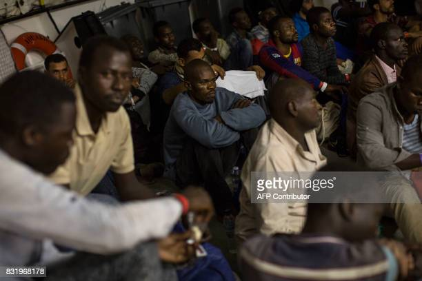 Migrants rest on the deck of the Aquarius rescue ship run by NGO SOS Mediterranee and Medecins Sans Frontieres after his transfer from the NGO...