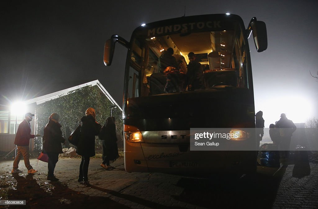 Migrants seeking asylum in Germany arrive by bus at a former office park that has become shortterm accommodation for migrants on November 2 2015 in...