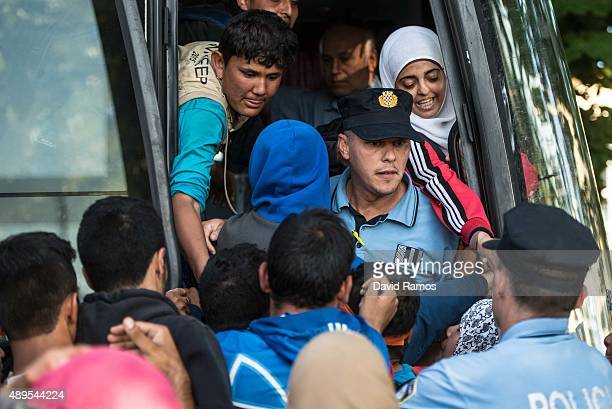 Migrants take a bus straight to the Hungarian border from a refugee camp as more migrants arrive from the Serbian border on September 22 2015 in...