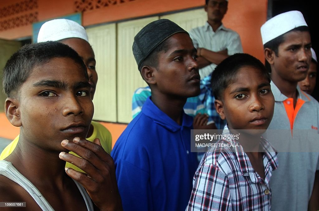 Migrants thought to be from Myanmar's Muslim-minority Rohingya are pictured at a detention centre after they were rounded up in raids on hidden camps in the Thai south, in Thailand's southern province of Narathiwat on January 16, 2013. The UN's refugee arm said on January 16 it had permission from Thailand to access some 850 people, many thought to be from Myanmar's Rohingya minority, held after raids on hidden camps in the Thai south. Hundreds of migrants have been arrested in the past week in police sweeps on remote areas in rubber plantations near the border with Malaysia, leading the UNHCR to seek to confirm whether any of them plan to seek asylum.