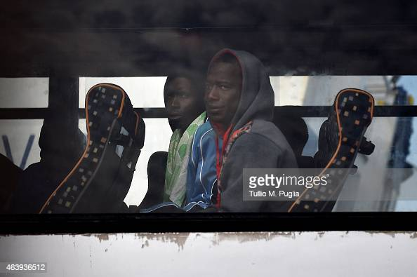 Migrants travel on a coach as they prepare to board a ship on February 20 2015 in Lampedusa Italy Hundreds of migrants recently arrived in Lampedusa...