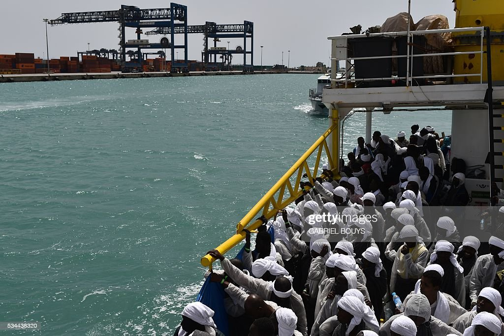 Migrants wait aboard rescue ship 'Aquarius' as they arrive in the port of Cagliari, Sardinia, on May 26, 2016, two days after being rescued near the Libyan coasts. The Aquarius is a former North Atlantic fisheries protection ship now used by humanitarians SOS Mediterranee and Medecins Sans Frontieres (Doctors without Borders) which patrols to rescue migrants and refugees trying to reach Europe crossing the Mediterranean sea aboard rubber boats or old fishing boat. / AFP / GABRIEL