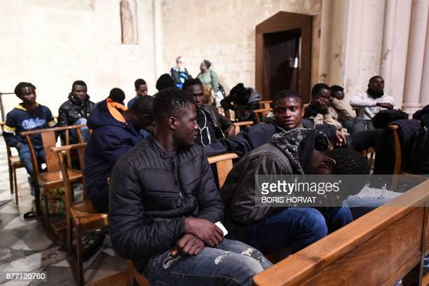 Migrants wait and sit as they occupy the church of Saint Ferreol in Marseille with members of associations on November 21 to protest against the life...