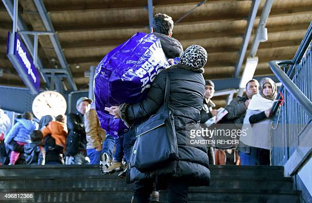 Migrants wait for a train to Copenhagen Denmark on November 12 2015 at the railway station in Flensburg northern Germany where refugees in transit...
